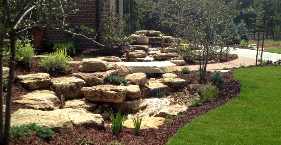 Lawn care snow removal green bay wi sharper edge for Garden design hobart